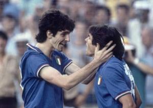 Paolo Rossi celebrates a goal with teammate Bruno Conti.