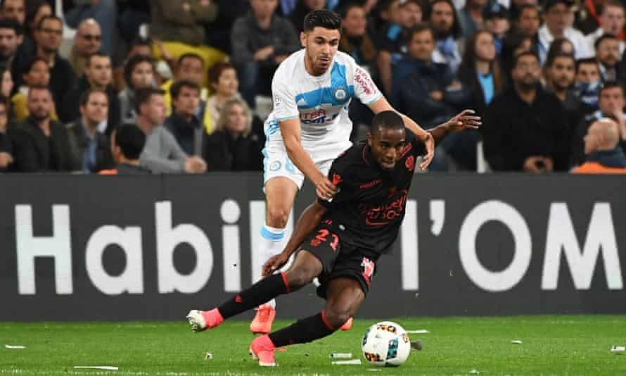 Marseille's Morgan Sanson, who is Ligue 1's top assist provider this season, tries to get the better of Nice's defender Ricardo Pereira.
