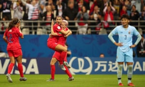 Alex Morgan of the US celebrates with Megan Rapinoe.
