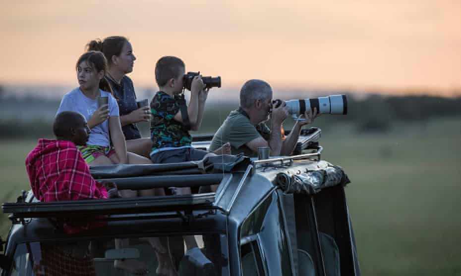 Tourists enjoy a wildlife game in the Mara North Conservancy, Kenya.