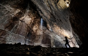 A potholer explores Gaping Gill, the largest cavern in Britain, in the Yorkshire Dales national park