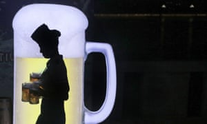"""A silhouette carries beer"""