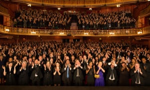 An audience giving a standing ovation