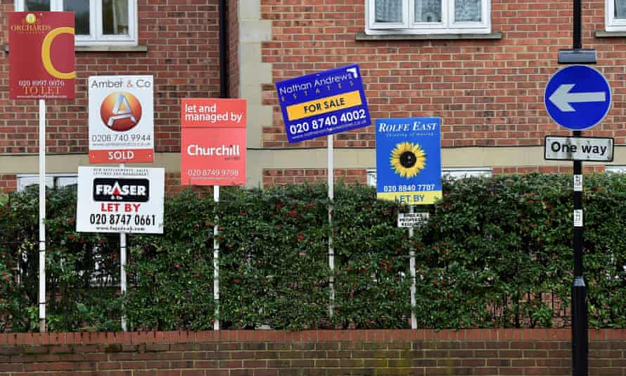 Property sale and rental signs on a London street in October.