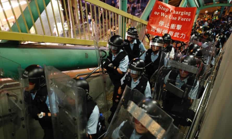 hong kong policeman on a bridge