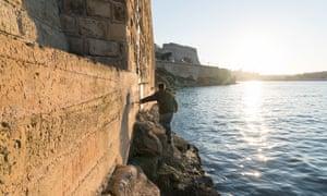Marc Zimmerman leading Garrett to the World War II submarine base underneath Valletta