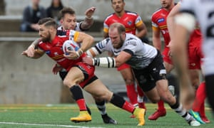 London's Jarrod Sammut attempts to break away from the Wolfpack during the Million Pound Game last October.