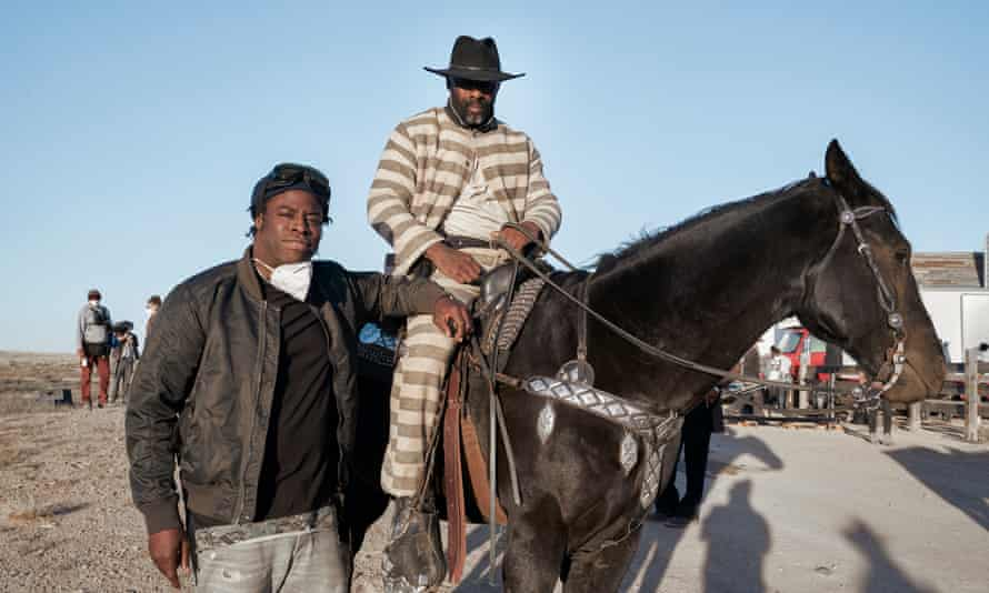 The Harder They Fall director Jeymes Samuel on set with Idris Elba.