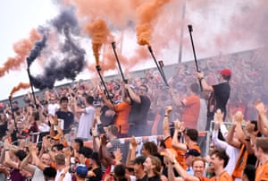 Roar fans show their support during the A-League match between the Brisbane Roar and Melbourne City at Dolphin Stadium in Brisbane, Australia