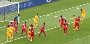 Australia's Mile Jedinak heads the ball goalwards.