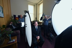 Governor Jared Polis filming a video message for an upcoming event in an office at the statehouse.