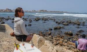 Spanish surfer Ariane Ochoa watches the men's heats in the Senegal Pro