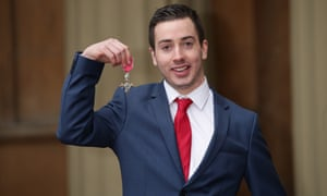 Charlie Fogarty at Buckingham Palace with his MBE, awarded for services to young people in Solihull.