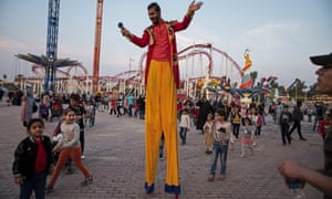 Stilt-walker Muhammed Samir puts on a show once a week at Zawra park.