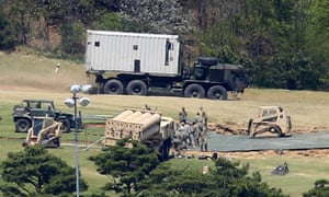 The Thaad missile defence system begins arriving in Seongju county.