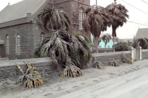 Ash covers palm trees and a church.