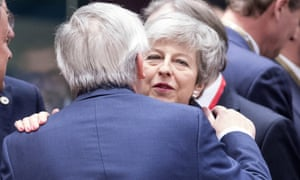 Theresa May greets European commission president, Jean-Claude Juncker.