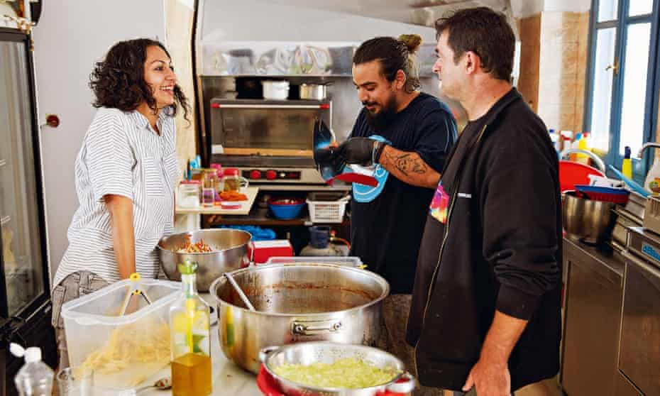 Yasmin Khan, left, with chefs from the Home for All community centre which provides free meals to refugees on Lesbos.