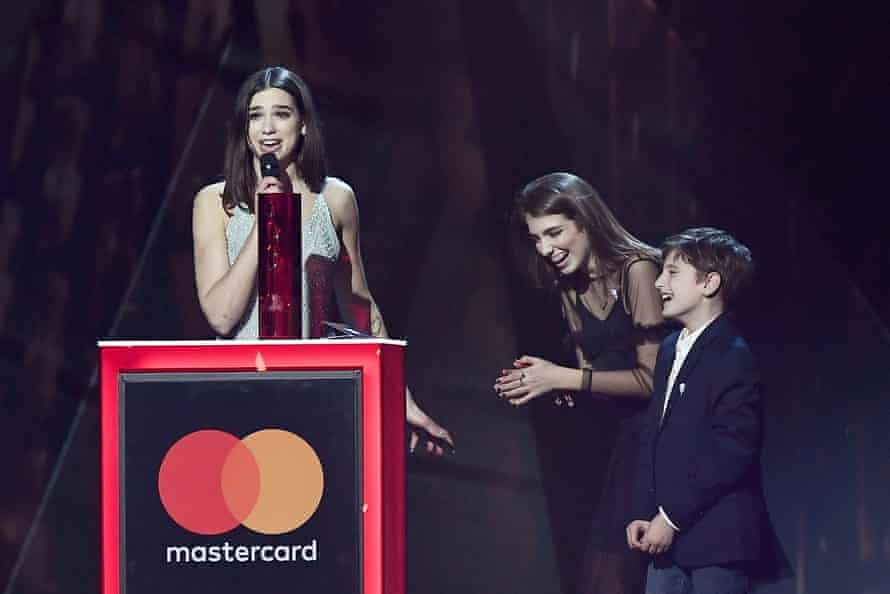 Lipa with her younger siblings at the Brit awards.