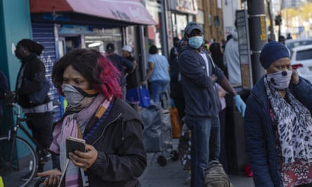 People wear an assortment of face masks on Walworth Road, London, in April.