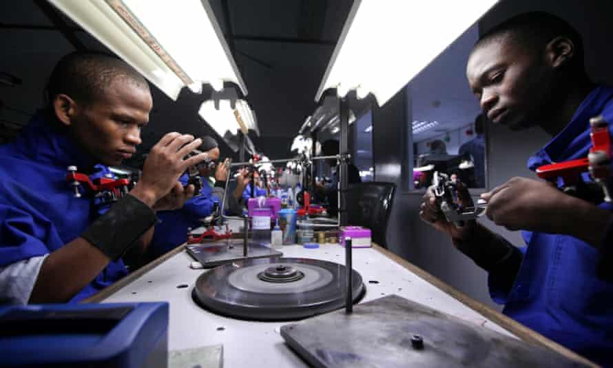 Employees prepare diamonds for polishing at the Shrenuj Botswana sightholder office in Gaborone, Botswana