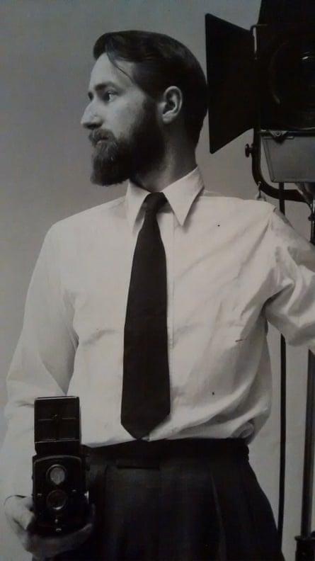A self portrait by Adrian Flowers in the mid-1950s, showing him with his trademark Rolleiflex camera.