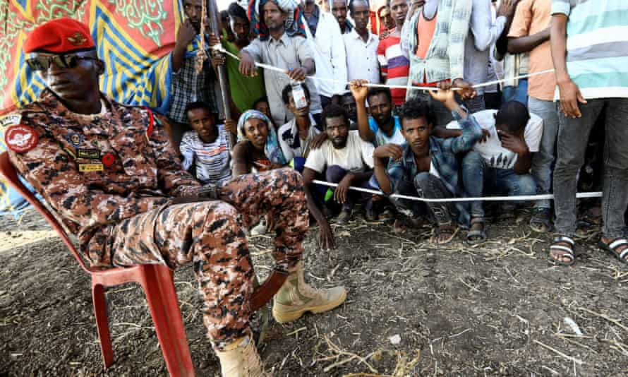 Ethiopians who fled war in Tigray at a camp on the Sudanese border.