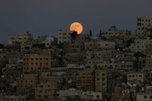 The moon hovers above the city of Amman, Jordan.