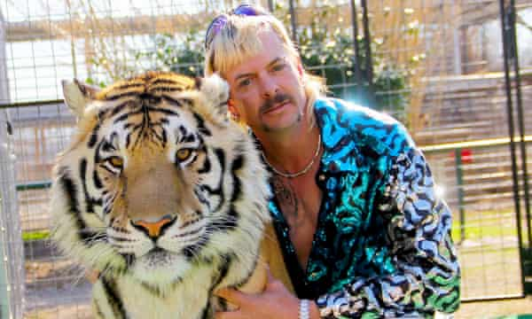 Joe Exotic with one of his tigers, the subject of Tiger King: Murder, Mayhem and Madness on Netflix