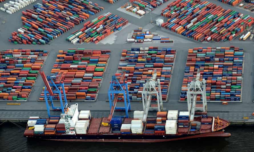 A container ship is loaded at a terminal in the harbour of Hamburg, Germany