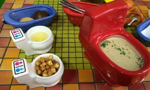 Mushroom soup served in a mini toilet.