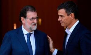 Mariano Rajoy and Pedro Sanchez (right) at La Moncloa palace in Madrid
