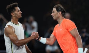 Rafael Nadal and Michael Mmoh greet each other at the net after their match.