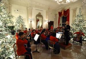 A military band plays Christmas music in the Grand Foyer.