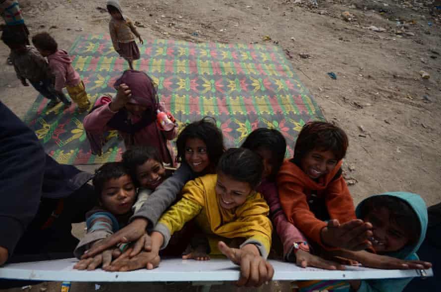 Children at the whiteboard of a mobile school near Peshawar, Pakistan.
