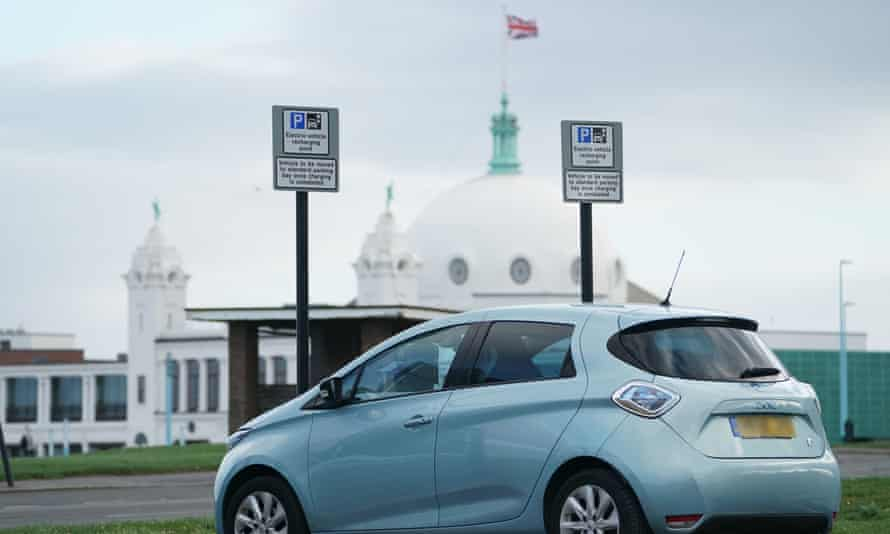 An electric vehicle at a recharging point in Tynemouth.