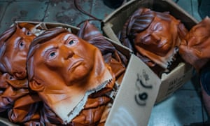 Masks of Donald Trump are seen in boxes at the Shenzhen Lanbingcai Latex Crafts Factory, which produces Halloween costumes and masks, in Shenzhen, China.