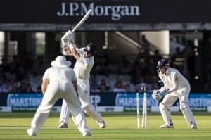 Boyd Rankin of Ireland is bowled by Moeen Ali of England.