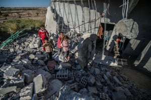 Children on the rubble of a building in the Jarabulus district. Families who returned to their homes in Jarabulus after its cleansing by Islamic State will try to rebuild their houses before winter