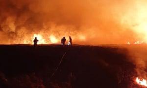 Firefighters tackle the blaze on Marsden Moor in April last year