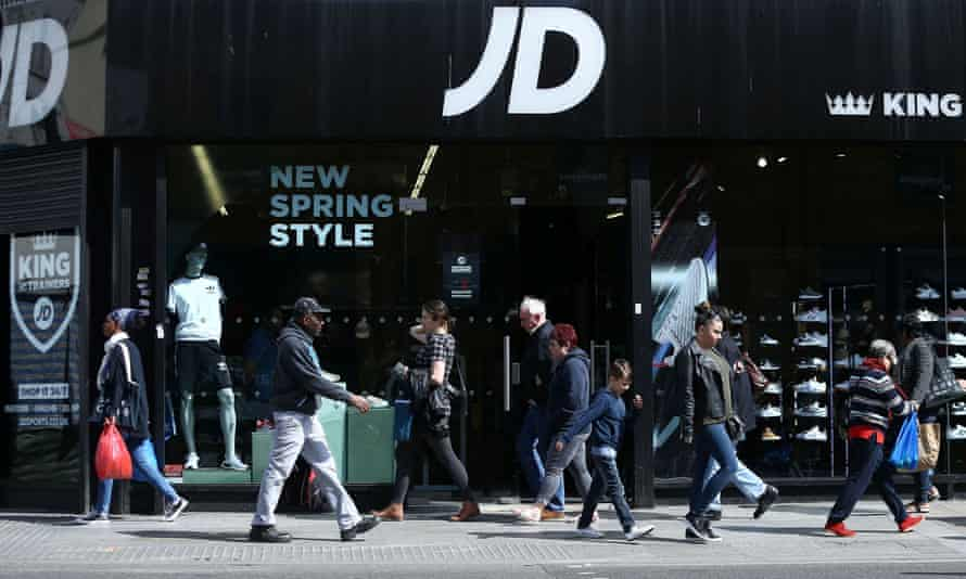 People pass a JD Sports store in London