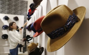 A woman looks at hats in a Borsalino store in downtown Milan, Italy