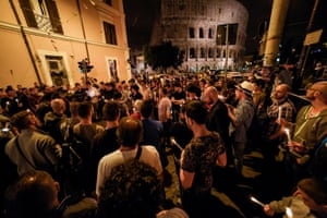 Rome, Italy. LGBT rights supporters hold candles near the Colosseum
