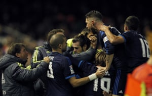 Bale celebrates with teammates.