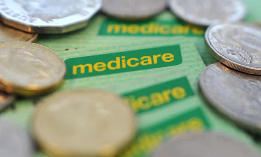 Medicare healthcare cards and coins. Photo taken January 2015.