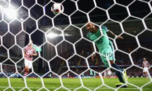 Ricardo Quaresma (R) of Portugal heads the ball to score the first goal.