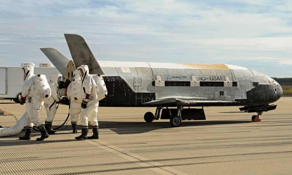 Recovery crew members process the X-37B Orbital Test Vehicle after an earlier mission.