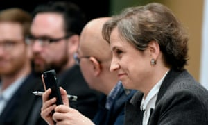 Mexican journalist Carmen Aristegui holds her mobile phone during a journalists' press conference in Mexico City on Monday about the software.