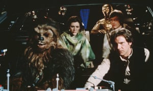 Peter Mayhew in costume as Chewbacca, left.