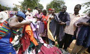 People buying clothes at the Katine market, a small village in north-east Uganda, Africa